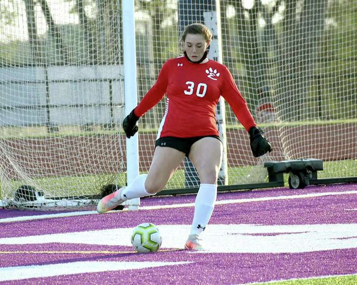 Edwardsville keeper Kaitlyn Naney takes a goal kick during the first half against Collinsville in Collinsville.