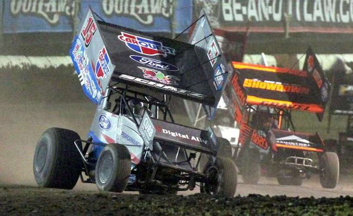 Cars race around the track Thursday night at the World of Outlaws NOS Energy Drink Sprint Car Series race at Jacksonville Speedway.