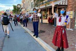 Employees line Main Street for Disneyland's reopening day on April 30.