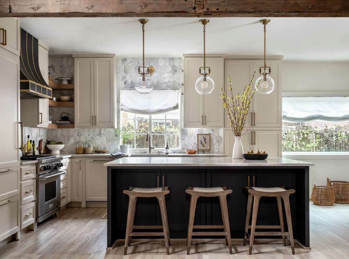 """The kitchen in Elizabeth and Dr. Mir Ali's Memorial Park home went from cookie cutter to """"warm modern"""" in a recent renovation."""