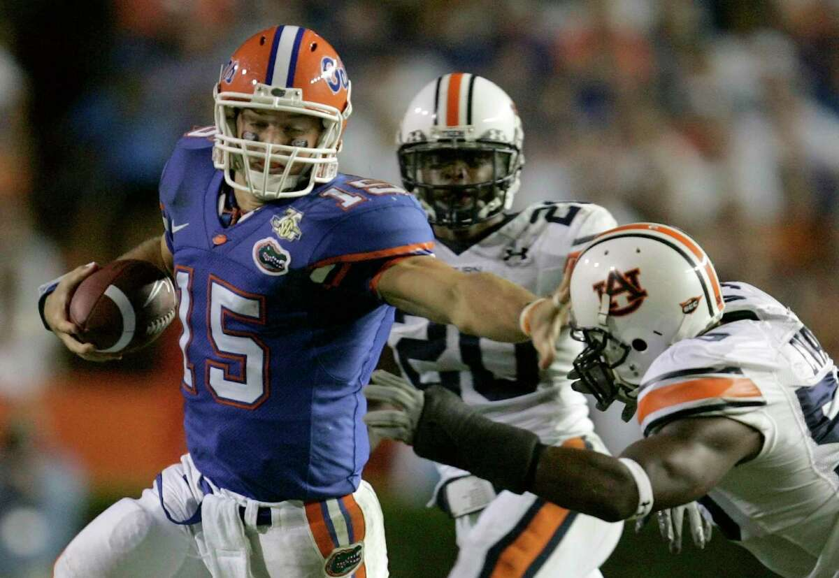 Florida quarterback Tim Tebow (15) is stopped by Auburn's Chris Evans (59) and Patrick Lee (20) during a college football game in this Sept. 29, 2007 file photo, in Gainesville, Fla.
