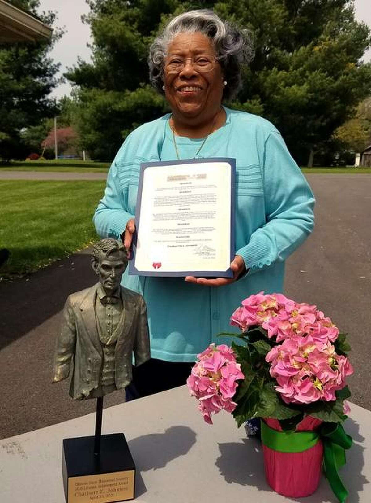 Charlotte E. Johnson of Alton on Friday received the 2021 Lifetime Achievement Award from the Illinois State Historical Society.