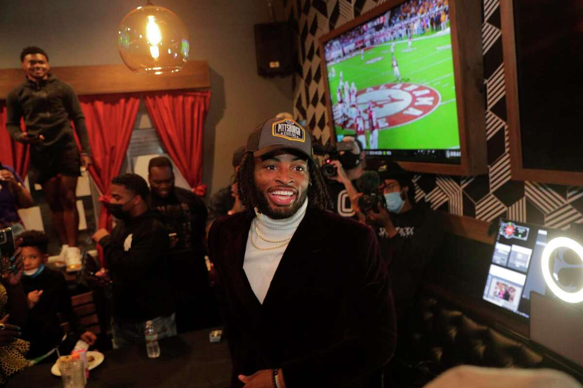 Najee Harris celebrates with family and friends after his selection in the 2021 NFL Draft at Rob Ben's restaurant in Emeryville Calif., on Thursday, April 29, 2021. Harris was picked 24th overall by the Pittsburgh Steelers.