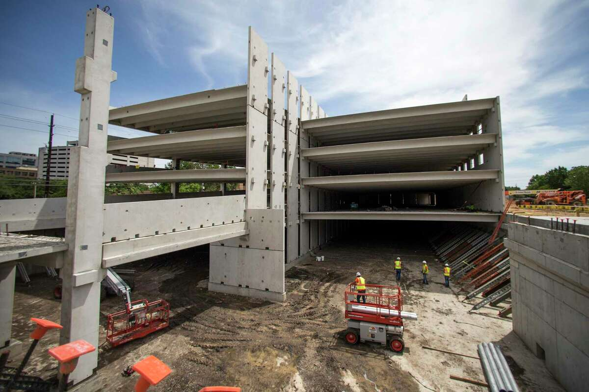 Construction continues Monday on the detention vault at Blackwell Medical Center apartments. The project is being developed with a vault under the parking garage to help mitigate flooding in the area.