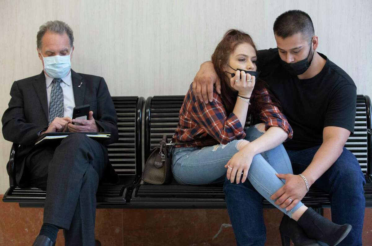 Defendant Brittney Mayfield, 24, and boyfriend Josiah Pool, 23, wait wth her attorney, Clay Conrad, to be called into court.