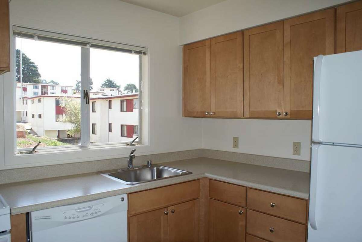 It looks like there is a dishwasher. There are also washer and dryer hookups in the kitchen. The living and dining area is just off the kitchen.