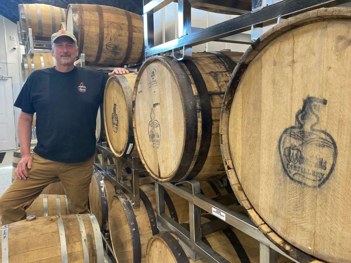 Dan Beardsley shows off the barrels lining the wall inside his new business, White Hills Distillery, located on his father's farm off Leavenworth Road. The distillery is to open in early June 2021.