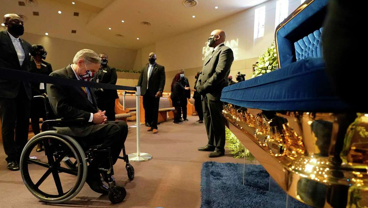 """Texas Gov. Greg Abbott passes by the casket of George Floyd during a public visitation for Floyd June 8 at the Fountain of Praise church in Houston. Abbott vowed legislation """"to make sure we never have anything like this ever occur in the state of Texas."""""""