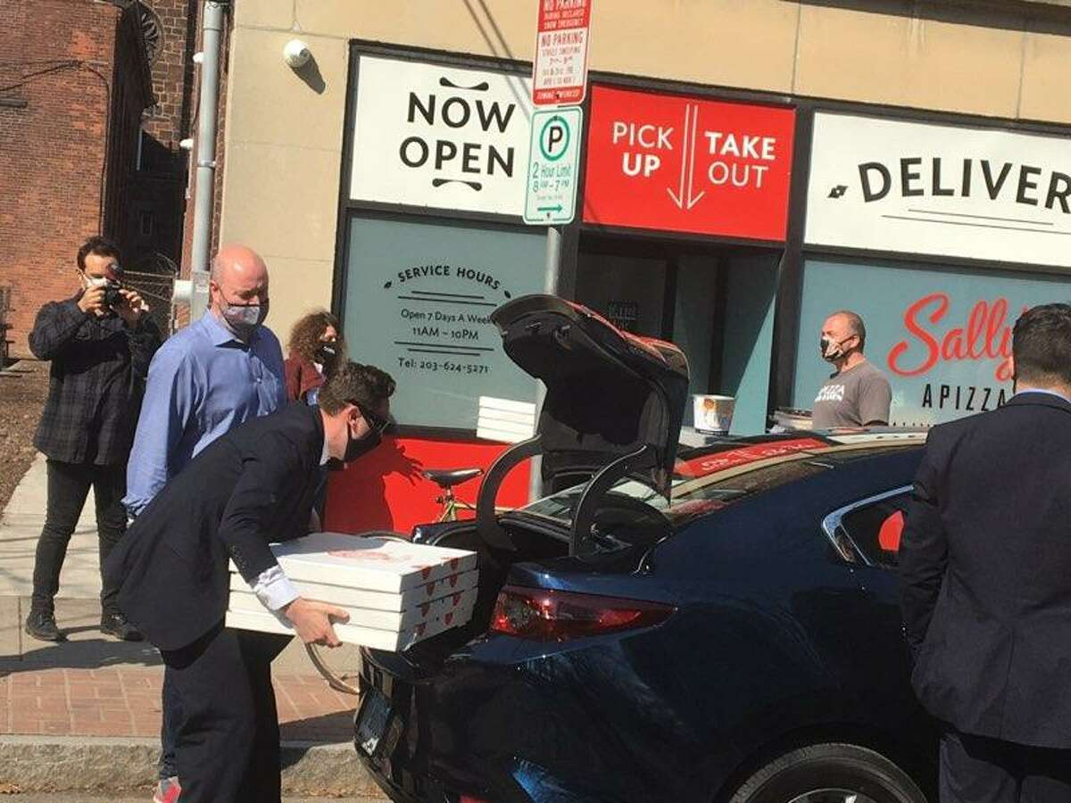 Pizzas are picked up from Sally's Apizza in New Haven.