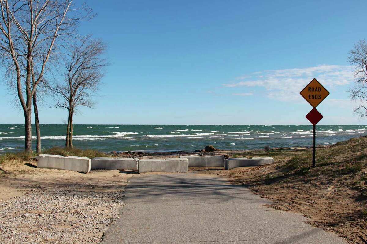 """This barricade at the end of Oak Beach Road blocks access to a disused boat launch. There used to be concrete blocks that were defaced with the words """"Tear down this wall"""" spray painted on them. (Robert Creenan/Huron Daily Tribune)"""