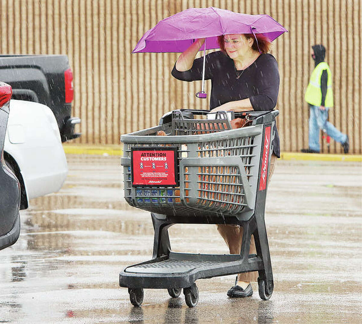 Alton attorney Amy Sholar joined other people Wednesday in bringing out their umbrellas to stay dry from the light but seemingly constant rainfall across the area.