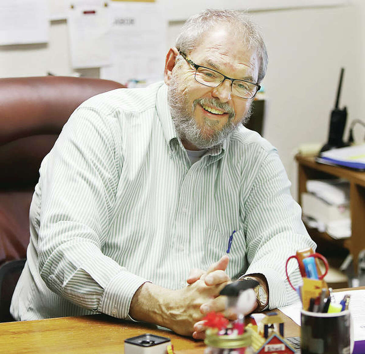 A smiling John Pearson, Superitendent of the East Alton-Wood River High School District, was all smiles as he talked about his career in education. Pearson is retiring in June.