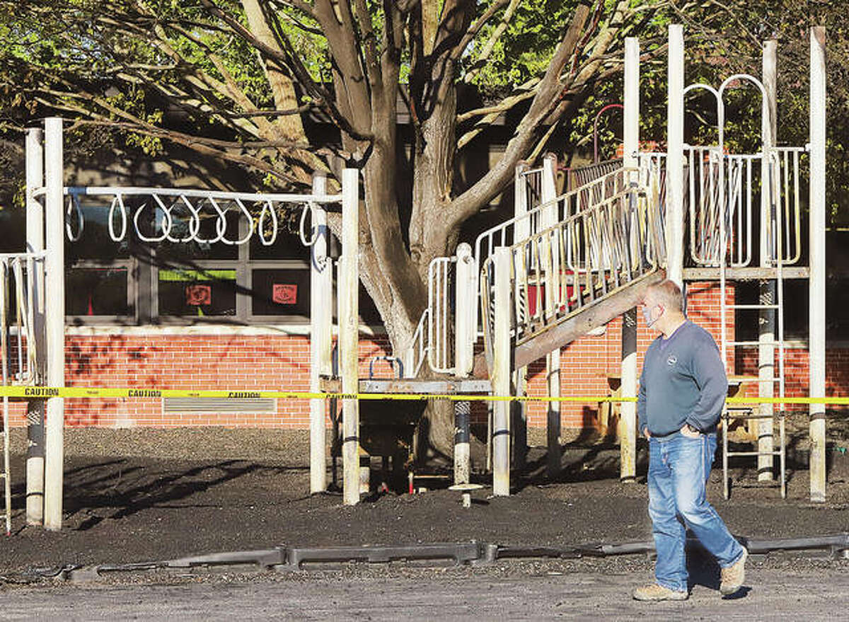 Alton School District employees were assessing destroyed playground equipment Friday behind West Elementary School on State Street. At about 1:30 a.m. Friday a fire apparently started in the ground-up rubber mulch under the playground equipment. A large tree overhanging the equipment was also damaged, a small amount of smoke damage was reported inside one room of the school. Alton firefighters contained the fire which did not actually burn the building, although a passerby reported the school appeared to be on fire.