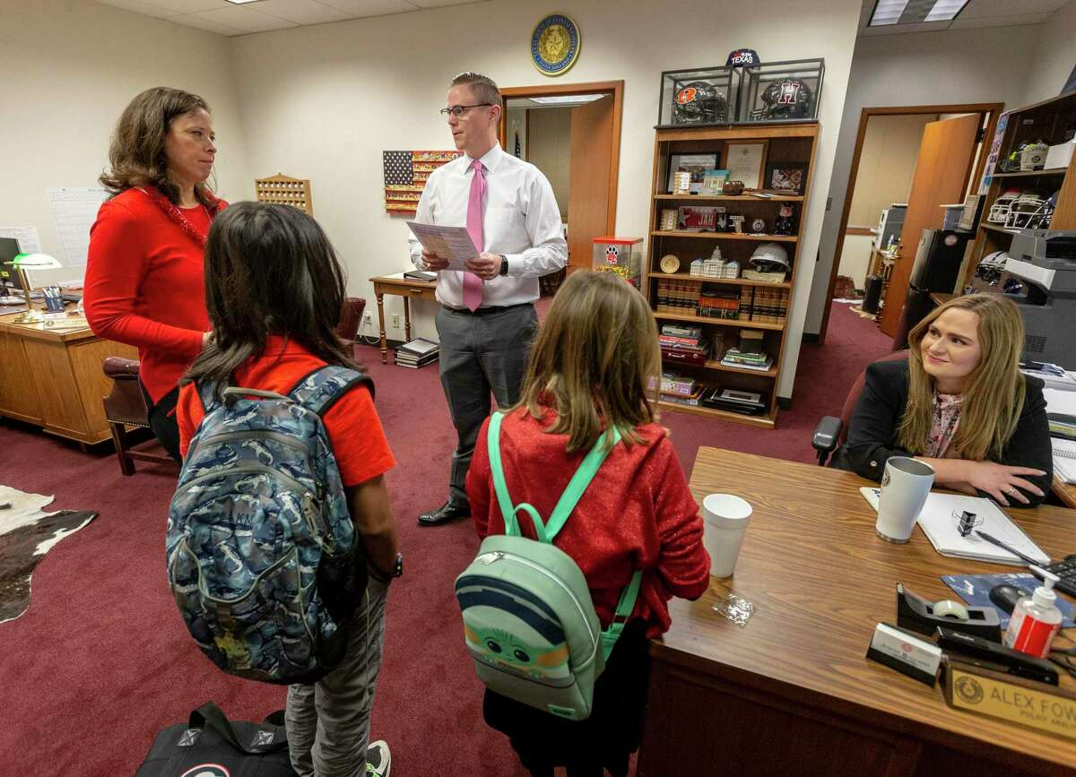 Stephanie Virag, left, and her children, Kaden, 12, and Kylie, 9, advocate Tuesday, April 27, 2021 in the state capitol to Rep. Justin Holland's chief of staff, Robert A. Paulsen, III for House Bill 3880 which would make it easier for dyslexic students to qualify for special education.