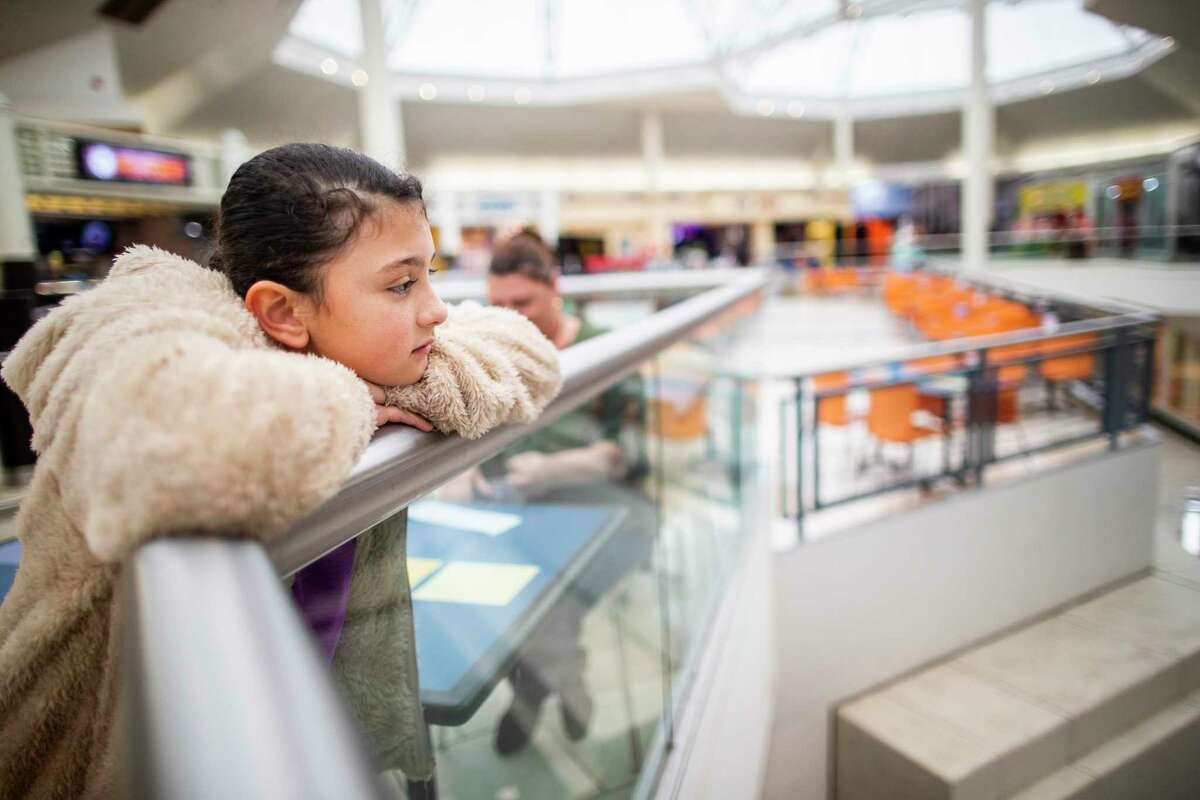 Amelia, 9, looks around the mall from the food court, in San Antonio. Although Amelia she was one grade level behind and testing showed she struggled with speech, reading and math, officials told her mother Rebecca said officials told her that Amelia she did not qualify because she was not several grade levels behind. After fighting with school officials for several months, Amelia qualified for special education in May 2019 and gets help with her dyslexia.