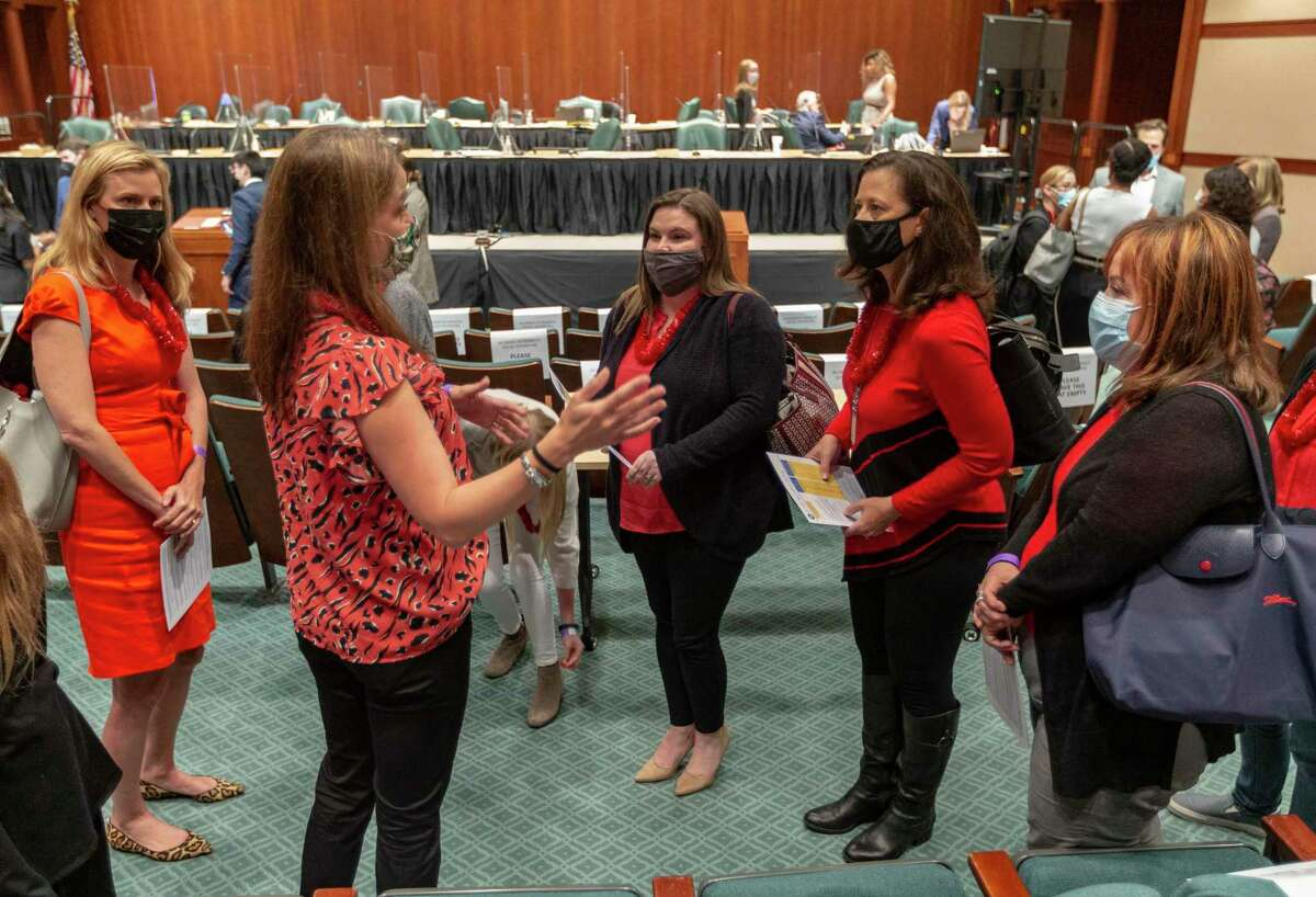 Supporters of House Bill 3880 gather Tuesday, April 27, 2021 in the Capitol extension complex during a break of the House Public Education Committee. The committee is scheduled to take up the bill Tuesday which would make it easier for dyslexic students to qualify for special education.