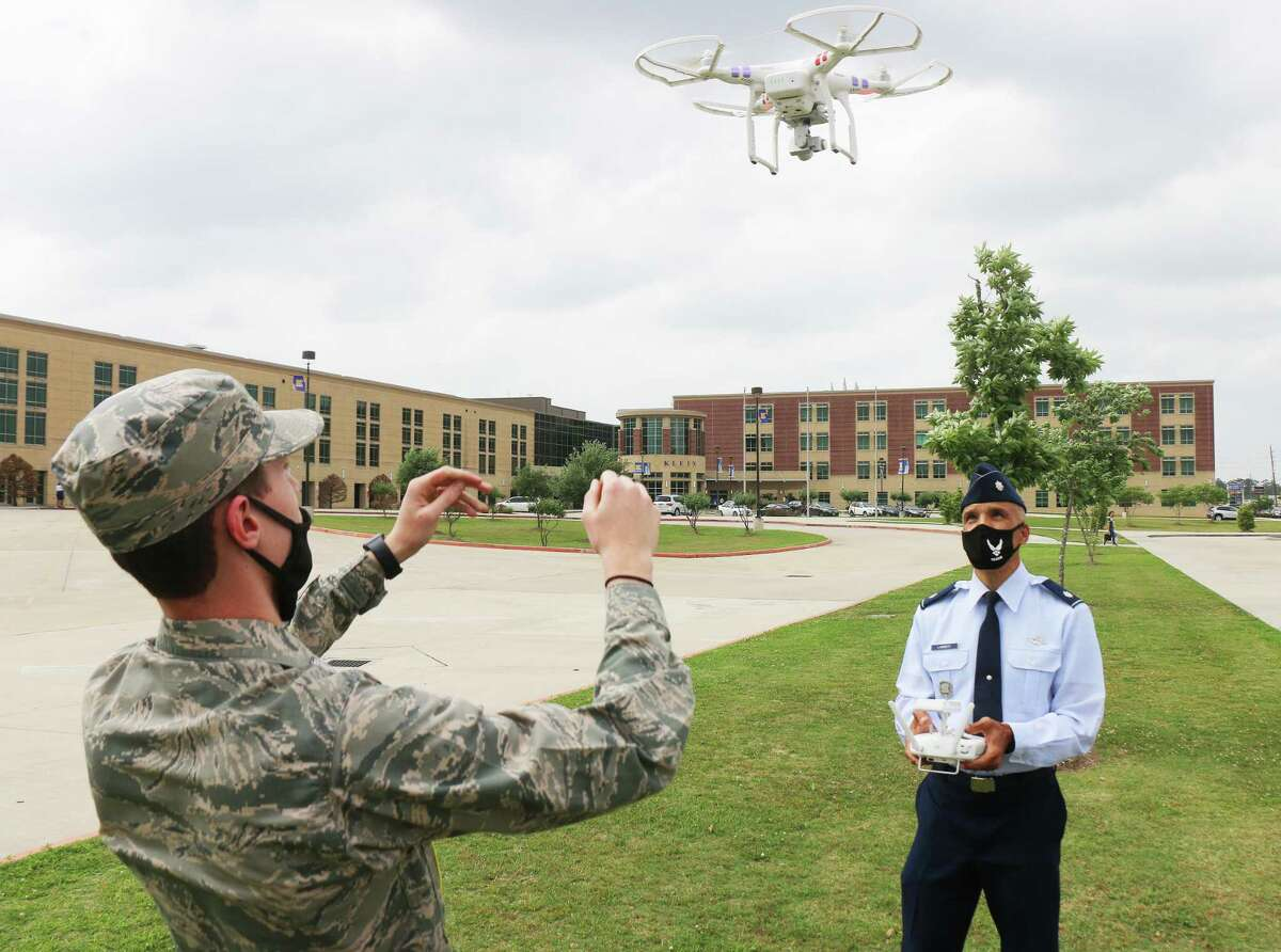 Senior Aerospace Science Instructor Lt. Colonel Timothy Lambert starts up the drone with the assistance of Cadet Sr. Master Sgt. Zach Farrell, a junior at Klein HS. The mini-sized aircraft is used for numerous tasks in the program and was furnished by the Air Force.