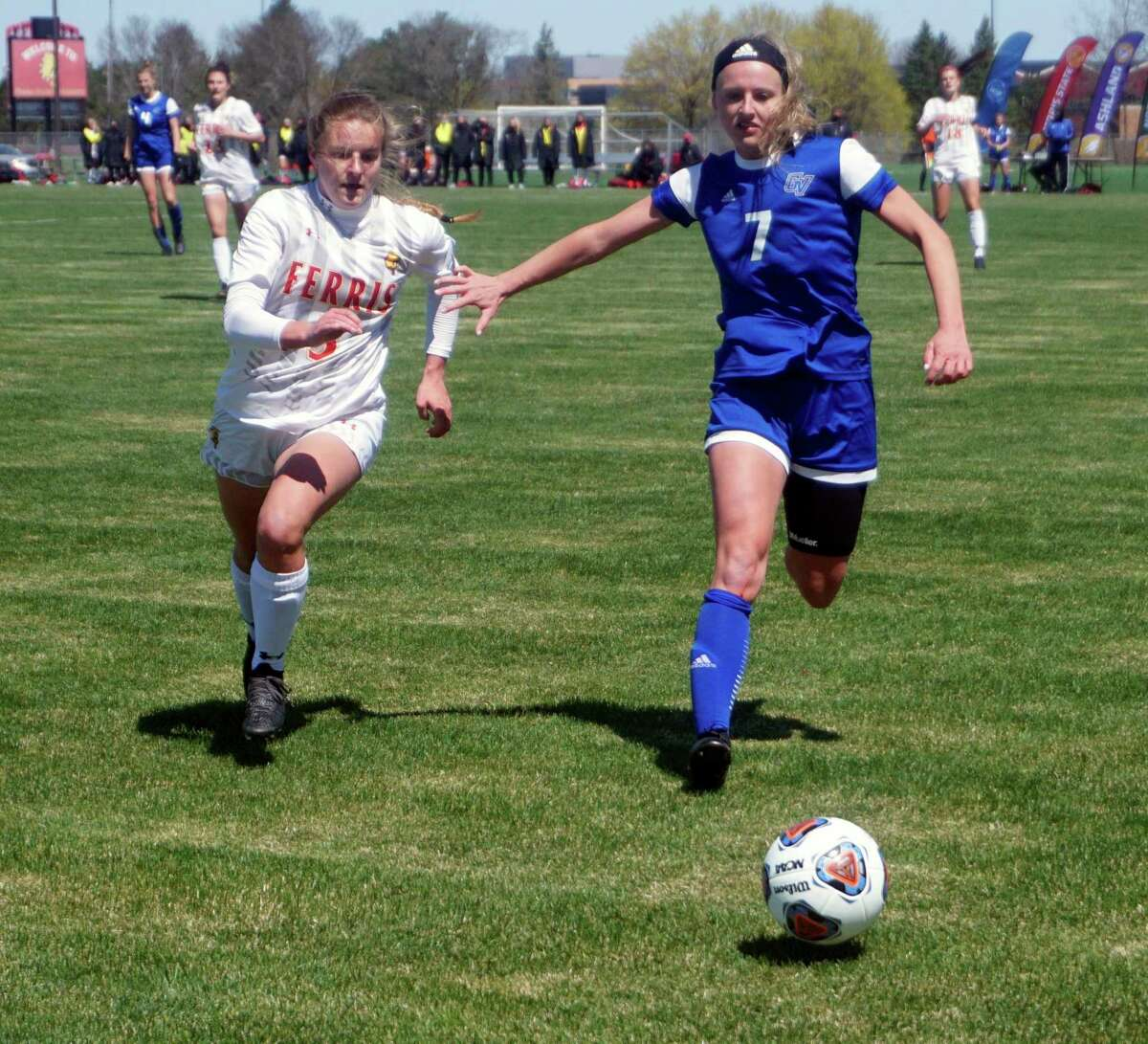 Ferris State junior Emily Mergener (left) and Grand Valley State senior Sydney O'Donnell chase down the ball during Friday afternoon's GLIAC semifinal soccer game. (Pioneer photo/Joe Judd)