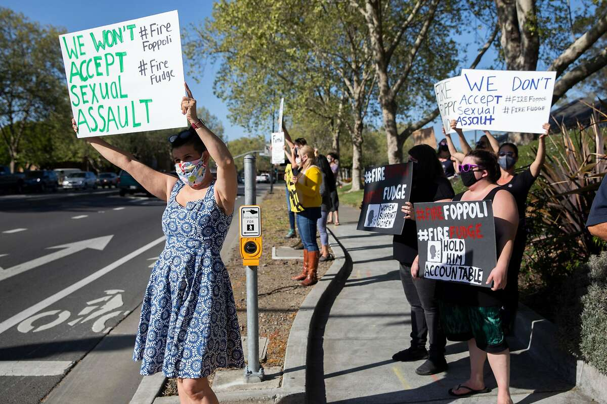 Sonoma County residents gather on the corner of Lakewood Drive and Old Redwood Highway in Windsor on April 9 to protest against Windsor Mayor Dominic Foppoli following the release of an investigation by The San Francisco Chronicle into multiple sexual assault accusations against Foppoli spanning decades.