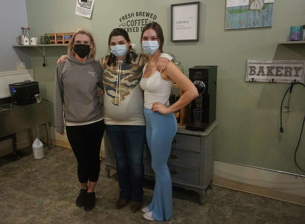 From left-to-right: Magnolia Boutique and Gifts employees Julia Logan-Henegar, Lacey Green and Emily Bouman pose in the coffee shop, also found inside of the store. (Pioneer photo/Joe Judd)
