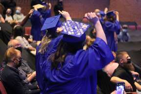 West Shore Community College nursing graduates move their tassels from right to left during a commencement ceremony at the Center Stage Theater on Thursday.