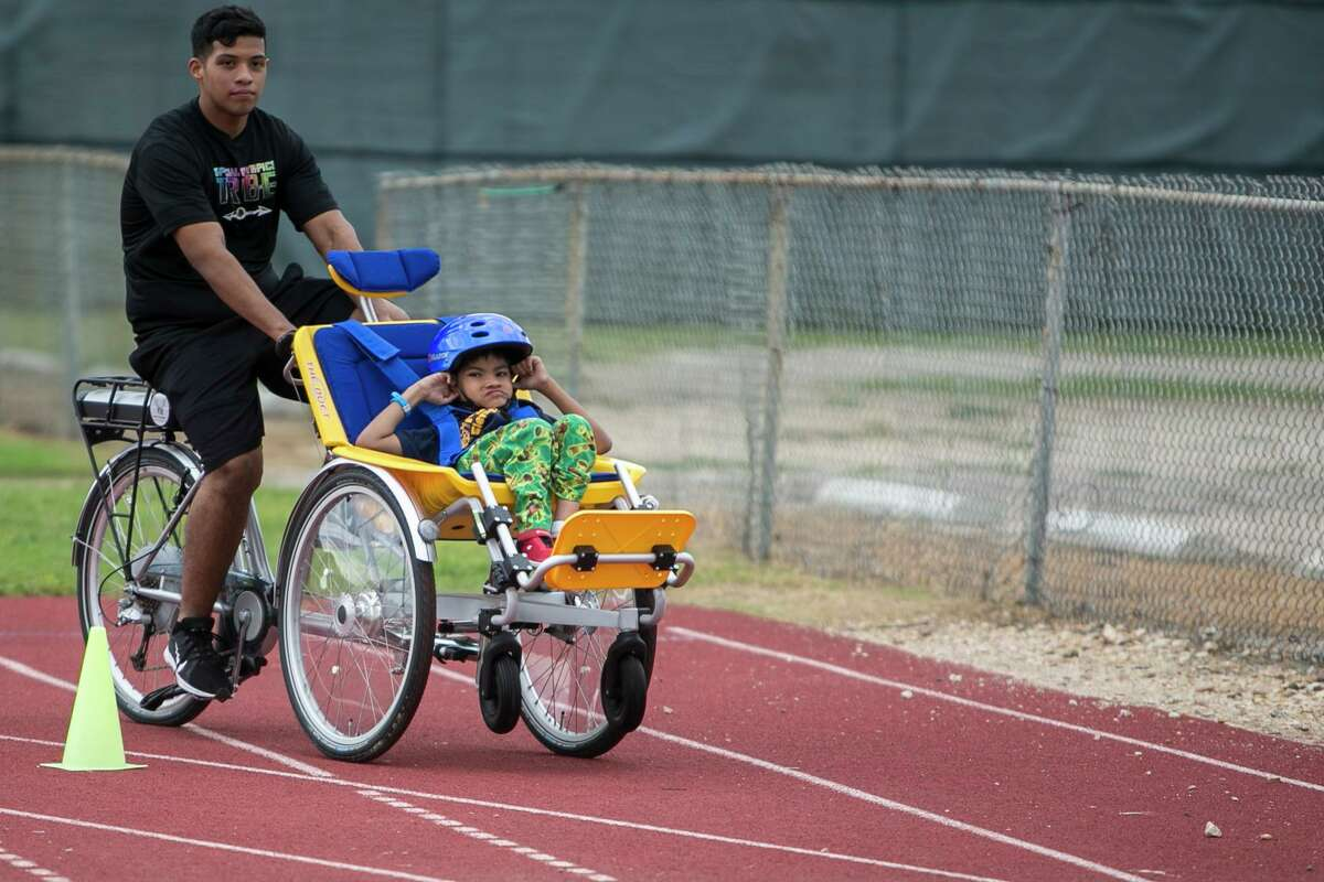Jockzan Hernandez Moreno rides in an adaptive bicycle during the community sports and bike day held at Harlandale Memorial Stadium on Oct. 11, 2018 in San Antonio.