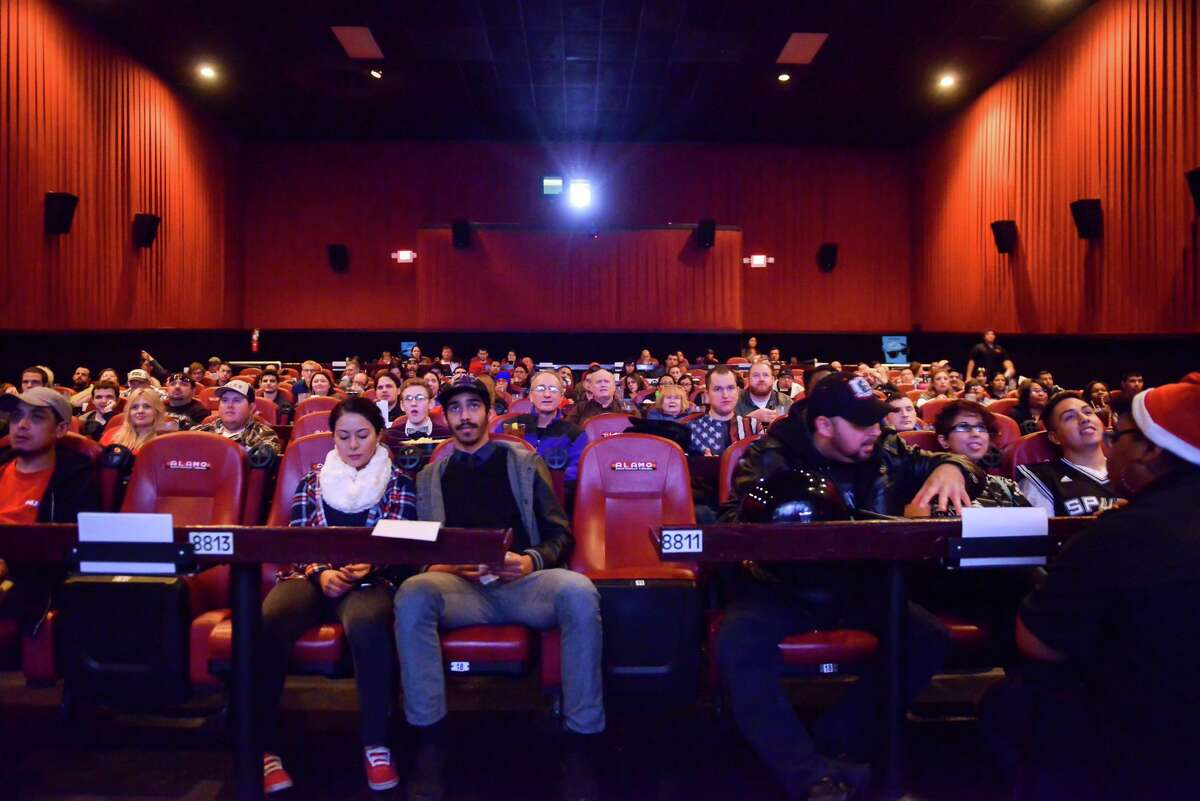 """A sold-out Westlakes Alamo Drafthouse theater audience awaits the start of first San Antonio showing of """"The Interview"""" on Christmas morning in 2014."""