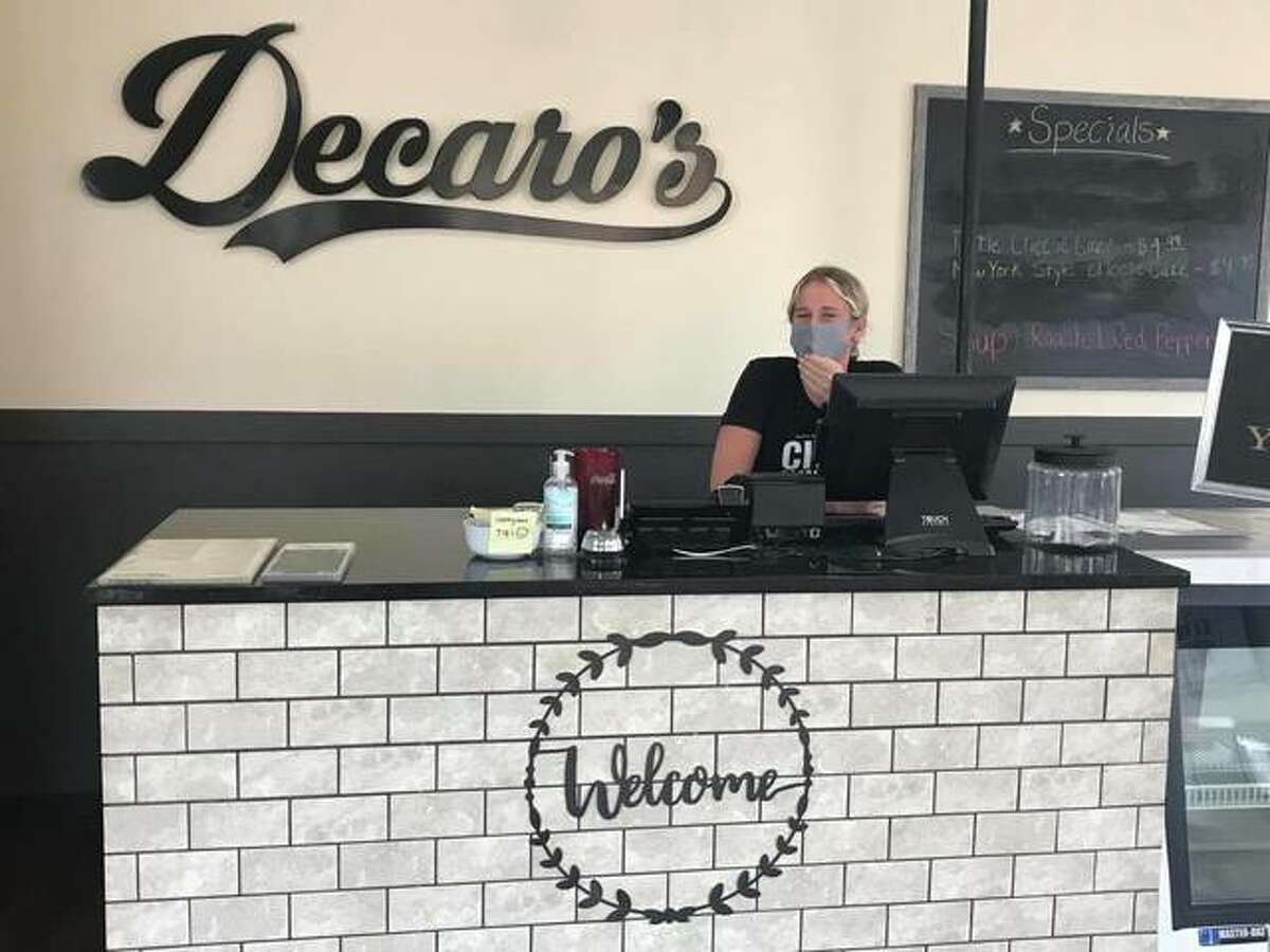 Caroline Stobbs behind the front counter at Decaro's, 602 E. 3rd St., in Alton, which opened in approximately 2018 by Eric Smith.