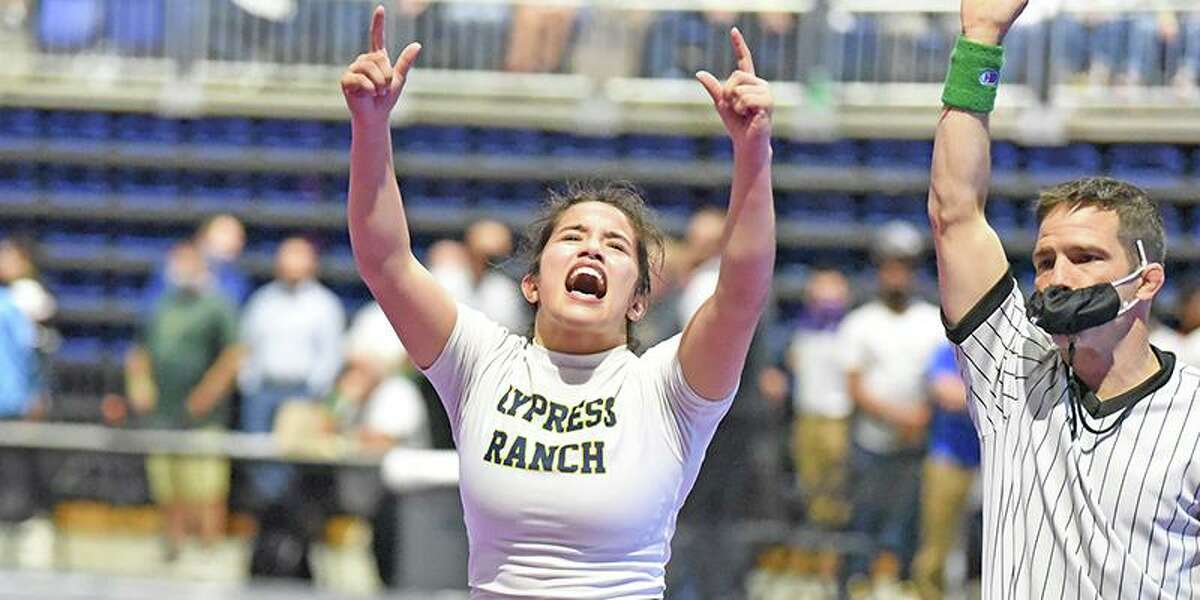 Cypress Ranch High School junior Jayden Bazemore celebrates winning the Class 6A 128-pound state title at the UIL Wrestling Championships on April 24 at the Berry Center.