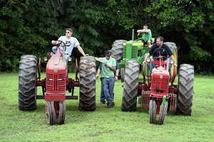 Contestants wait their turn during the tractor pull competition at the Potato and Corn Festival in North Branford on August 4, 2018.