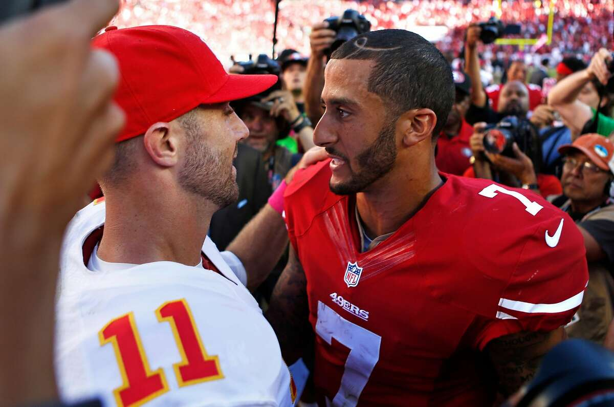 Alex Smith (left) of the Kansas City Chiefs faces off against Colin Kaepernick of the San Francisco 49ers in 2014.