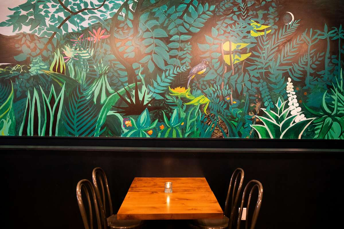 A colorful junglemural is painted in the upper dining area of Otra in the Haight-Ashbury neighborhood of S.F.