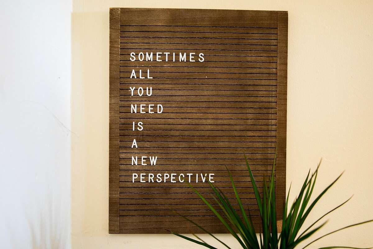 An inspirational sign hangs on the walls of therapist Stephanie McWoods' Onyx Perspective Therapy office in Oakland.