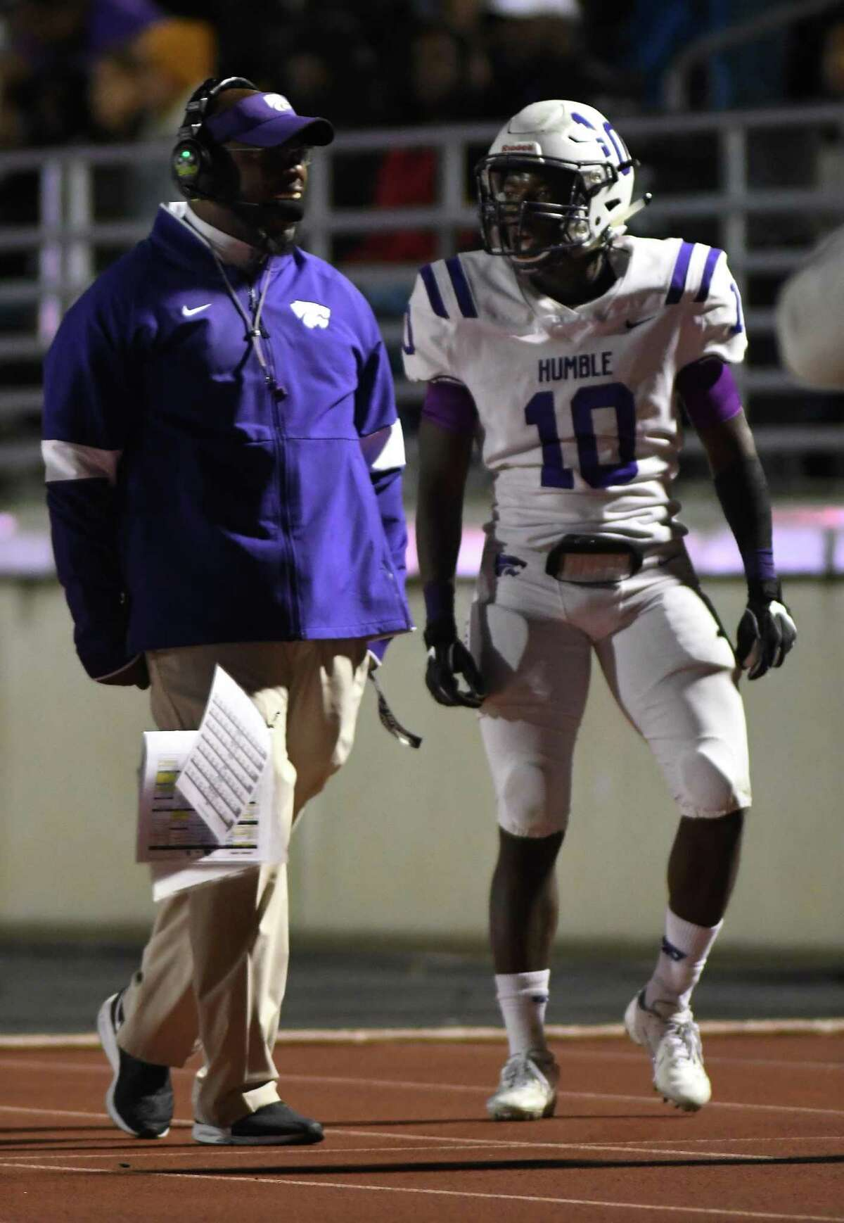 Humble Head Football Coach Charles West, left, congratulates senior wide receiver Donald Harper (10) after his touchdown catch in the 4th quarter of their District 22-6A matchup with Summer Creek at Turner Stadium on Oct. 11, 2019