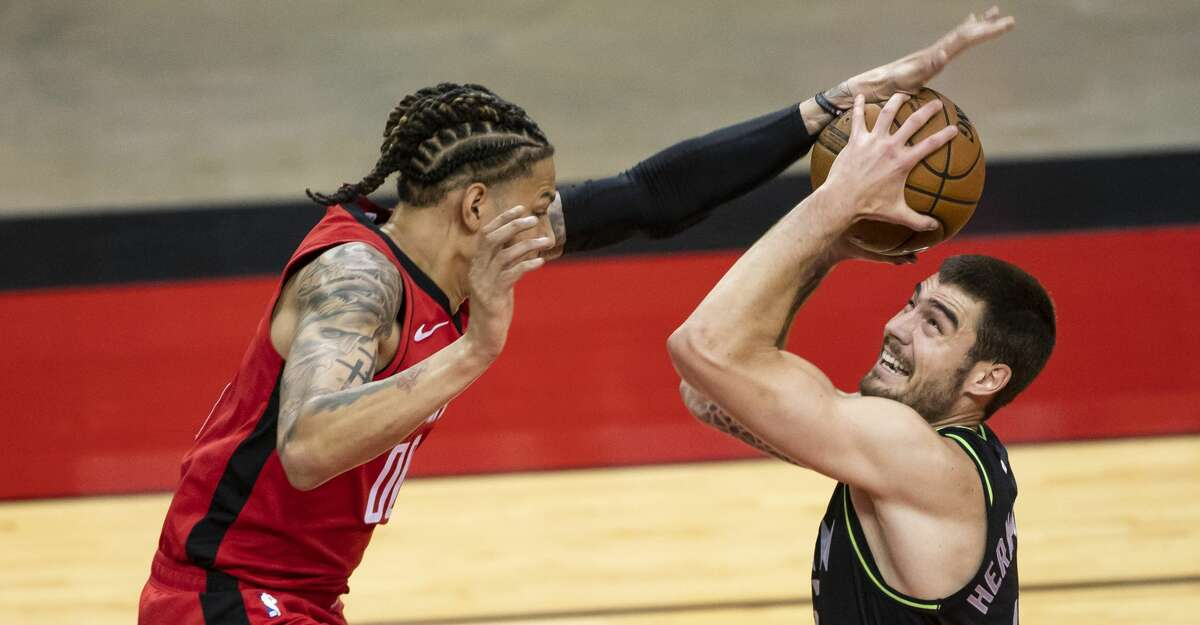 Houston Rockets forward D.J. Wilson (00) tries to block a shot by Minnesota Timberwolves forward Juancho Hernangomez (41) during the second quarter of an NBA game between the Houston Rockets and Minnesota Timberwolves on Tuesday, April 27, 2021, at Toyota Center in Houston.