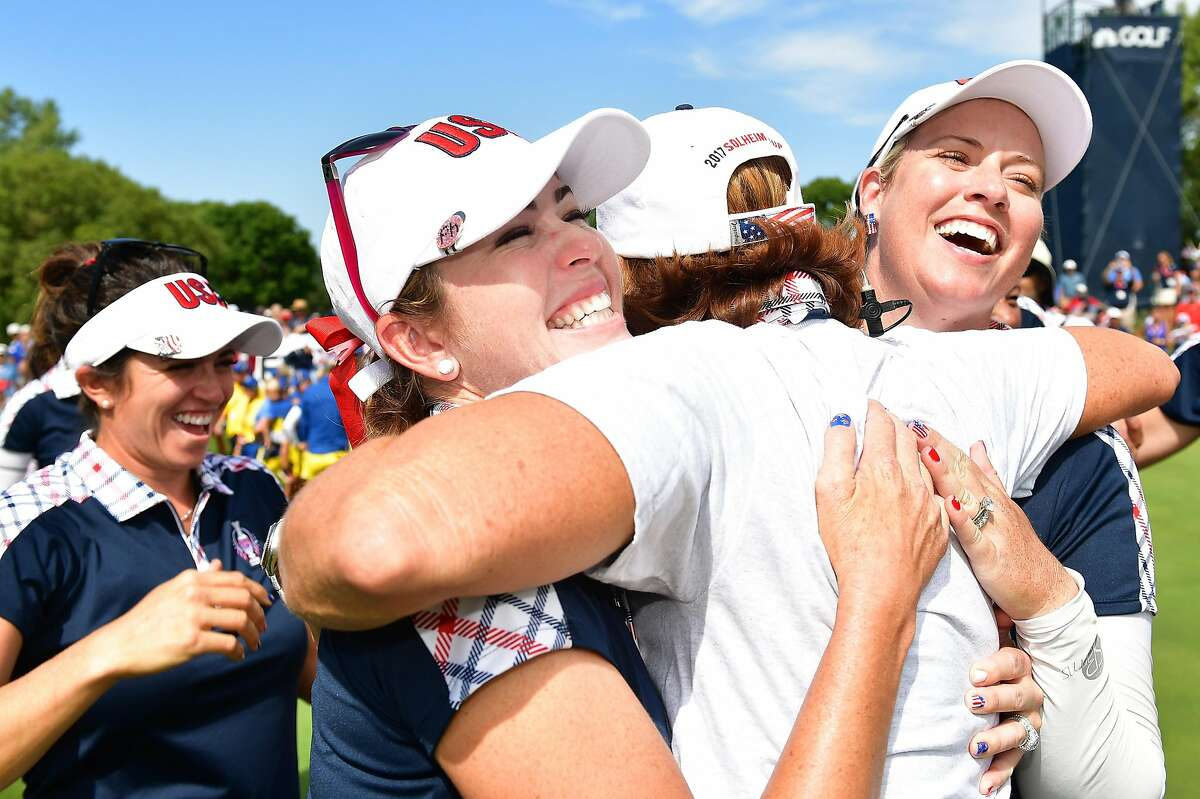 Juli Inkster celebrates with Paula Creamer (left) and Brittany Lincicome of Team USA after the final-day singles matches of the 2017 Solheim Cup at in West Des Moines, Iowa.