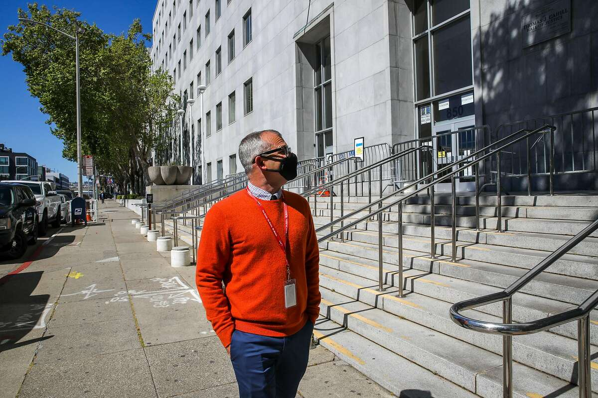 Gary McCoy, director of public affairs at HealthRight 360, walks outside the Hall of Justice, where he had served time in jail. Now in recovery for about 10 years, he's telling the story for the first time of his years of homelessness and drug addiction.