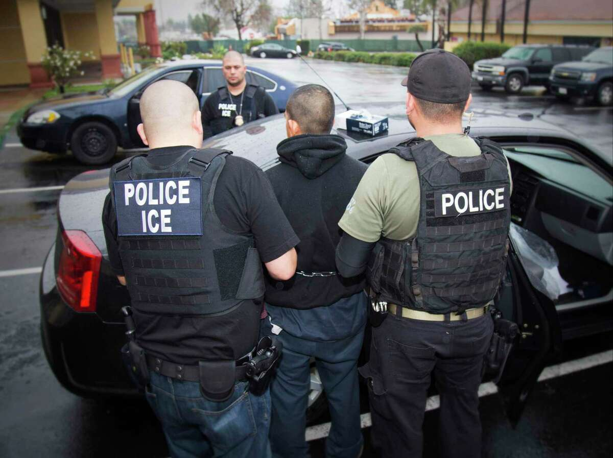 """File - In this Tuesday, Feb. 7, 2017, photo released by U.S. Immigration and Customs Enforcement, foreign nationals are arrested during a targeted enforcement operation conducted in Los Angeles by U.S. Immigration and Customs Enforcement (ICE) aimed at immigration fugitives, re-entrants and peoplethe agency referred to at the time as """"at-large criminal aliens."""" Many were found (Charles Reed/U.S. Immigration and Customs Enforcement via AP, File)"""