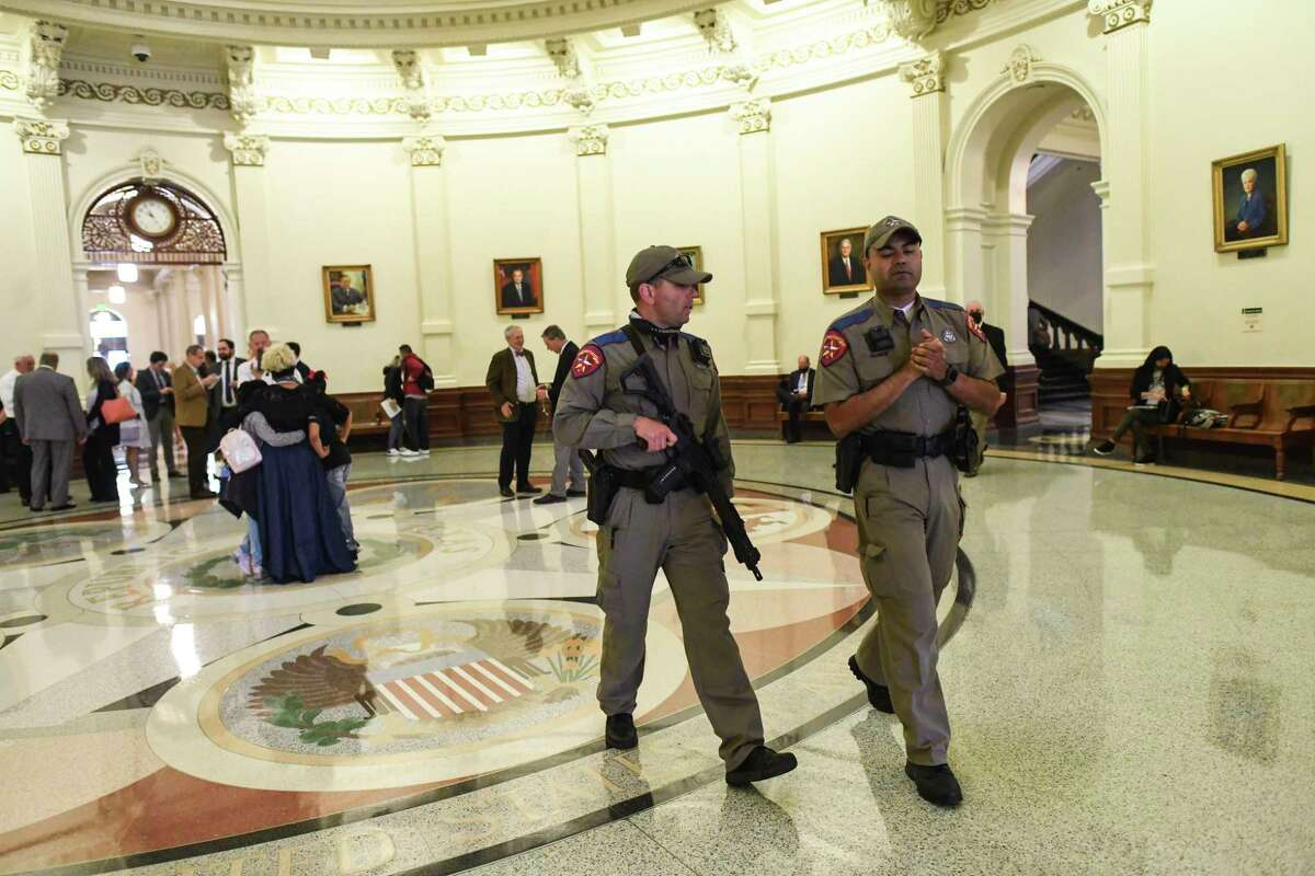 State law officers walk in the Texas Capitol as the legislature discusses permitless gun carry on Thursday, April 15, 2021.