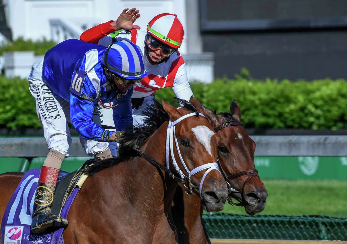 Jockey John Velazquez on Malathaat gets a pat on the back from jockey Irad Ortiz Jr. on Search Results after winning147th running of the Kentucky Oaks over Search Results with Iran Ortiz Jr. at Churchill Downs Race Track Friday April 30, 2021 in Louisville, Kentucky. Photo Special to the Times Union by Skip Dickstein