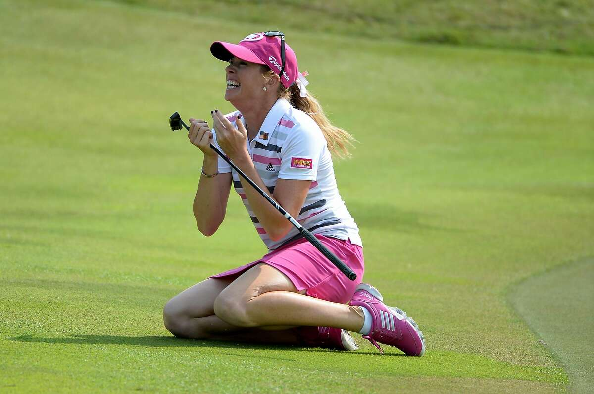 Paula Creamer celebrates after improbably holing a 75-foot eagle putt to win in a playoff against Azahara Munoz at the 2014 HSBC Women's Champions in Singapore.
