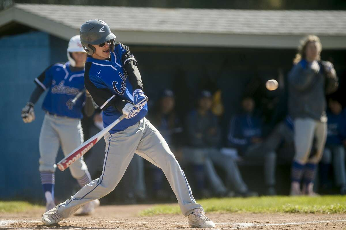Coleman's Ethan Anderson swings on a pitch during the Comets' game against Sacred Heart Academy Friday, April 30, 2021 at Coleman High School. (Katy Kildee/kkildee@mdn.net)