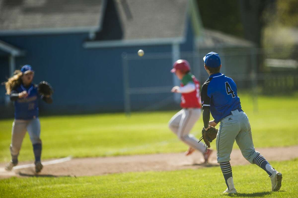 Coleman's Ty Murray throws the ball to third baseman Konner Carbeno during the Comets' game against Sacred Heart Academy Friday, April 30, 2021 at Coleman High School. (Katy Kildee/kkildee@mdn.net)