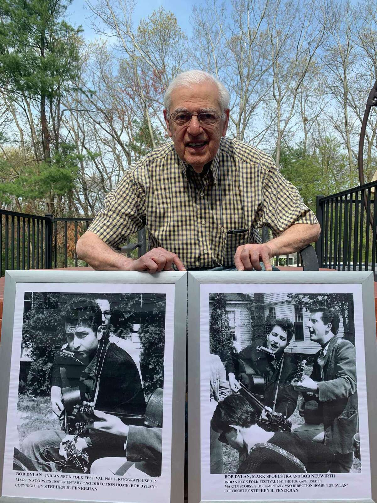 Stephen H. Fenerjian, 87, shows off two of the photographs he took of Bob Dylan at the 1961 Indian Neck Folk Festival in Branford when Fenerjian was 27. The photo of Fenerjian was taken by his son, Stephen M. Fenerjian, also known as Stephen Fenerjian Jr.