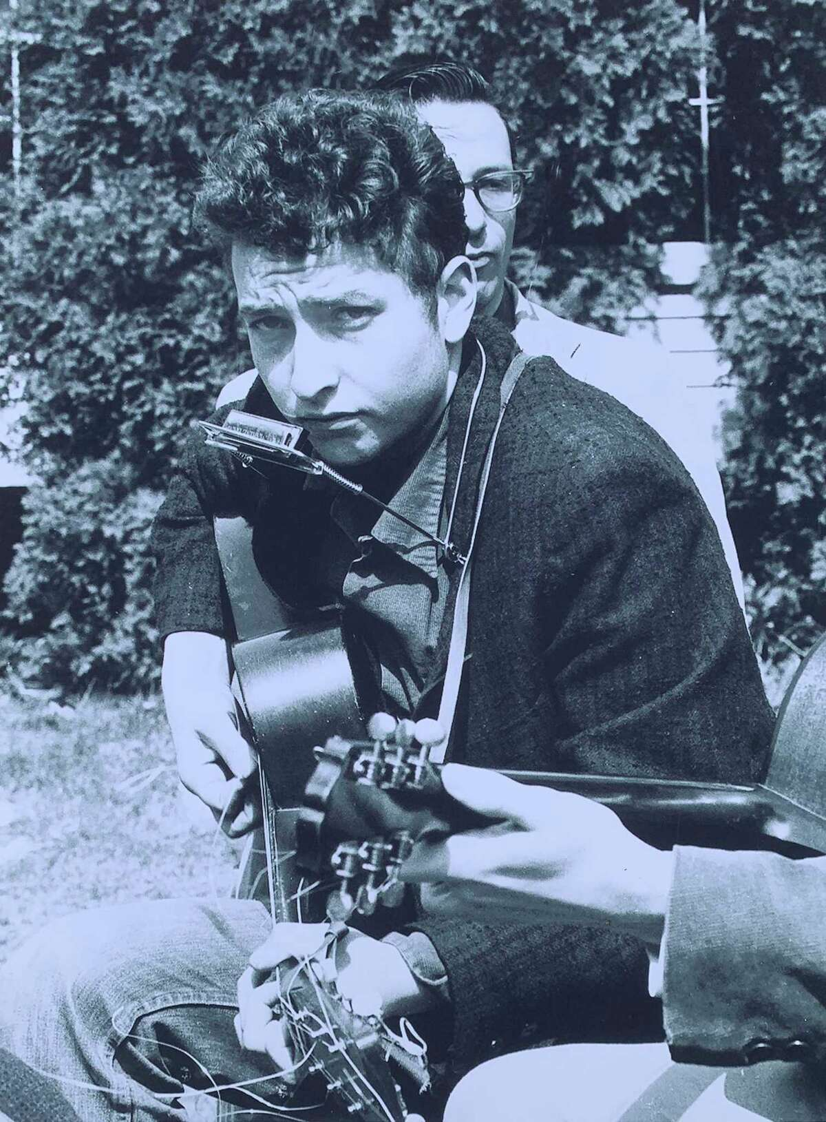 Bob Dylan, then 19, performing at the 1961 Indian Neck Folk Festival in Branford. The photo was taken by Stephen H. Fenerjian, a then-27-year-old Cambridge, Mass., photographer. Fernerjian now is 87 and living in Sharon, Mass.