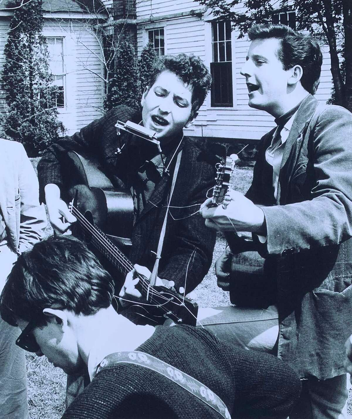 Bob Dylan, then 19, center, jams with Mark Spoelstra, right, and Bob Neuwirth, lower left, at the 1961 Indian Neck Folk Festival on May 6, 1961. The photo was taken by Stephen H. Fenerjian, a then-27-year-old Cambridge, Mass., photographer. Fernerjian now is 87 and living in Sharon, Mass.