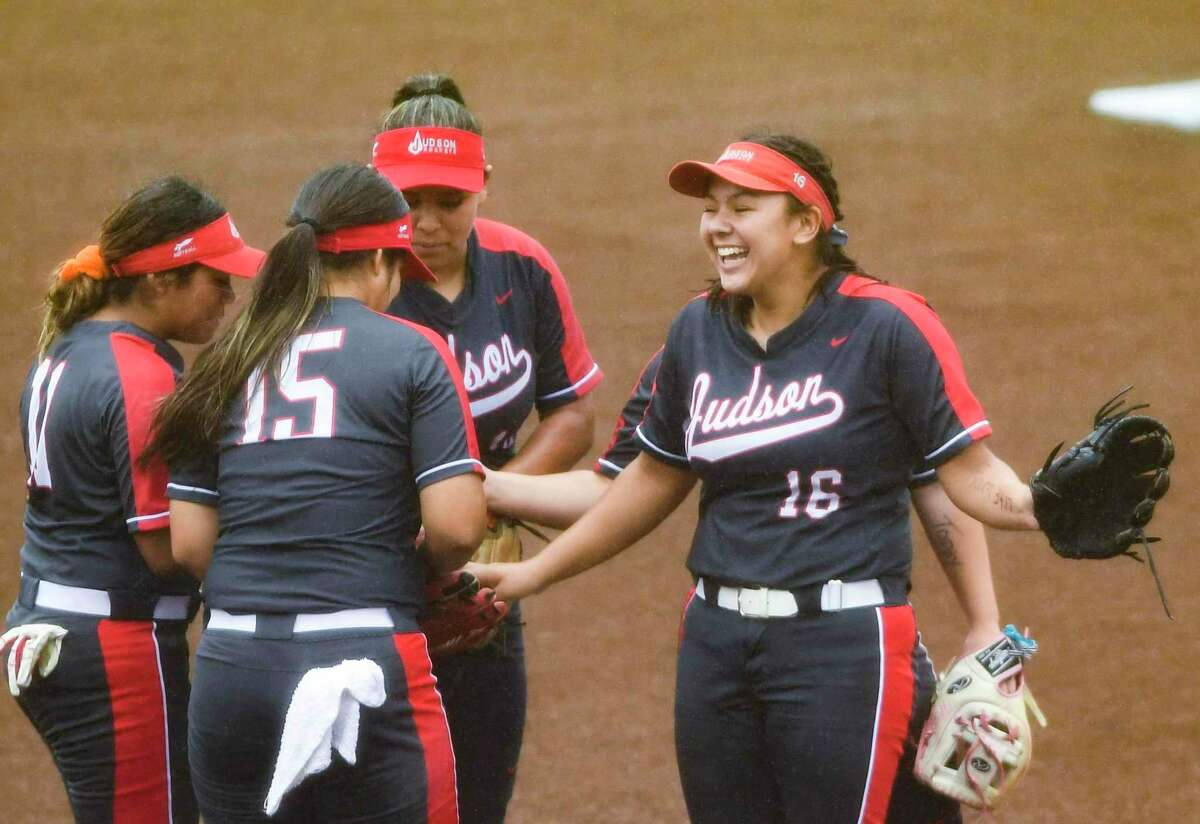 Emily Ayala (16) smiles with her Judson teammates during a meeting on the mound during their softball playoffs game against Clark at the Northside Field No. 2 on Friday, April 30, 2021.