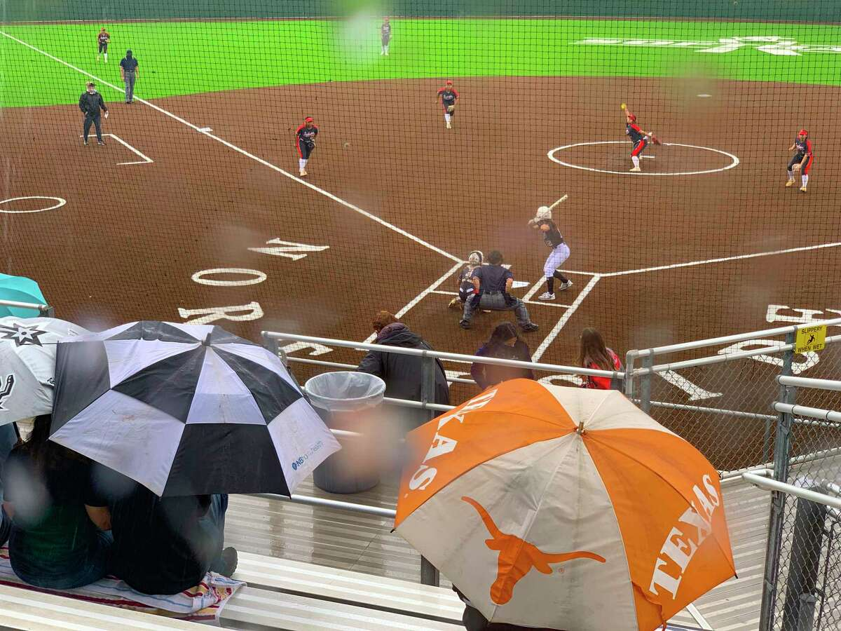 The Judson Rockets and Clark Cougars play as rain falls during softball playoffs action at the Northside Field No. 2 on Friday, April 30, 2021.