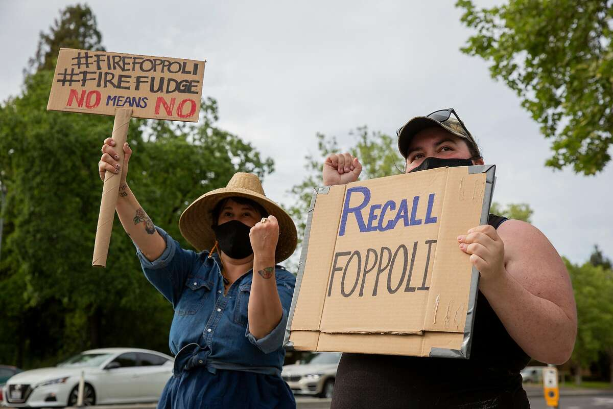 Rachel Wilcock (left) and Vanessa Petersen successfully call for a passing big rig to honk in support of their protest on the corner of Old Redwood Highway and Lakewood Drive in Windsor. A demonstration was held to demand a recall of Windsor Mayor Dominic Foppoli, following allegations of sexual assault reported by The San Francisco Chronicle.