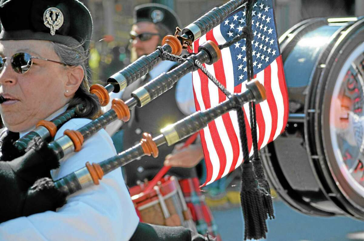 Tom Caprood/Register Citizen ¬ Members of the Litchfield Hills Pipe Band marched in Torrington's Memorial Day Parade.